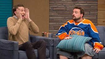 Kevin Smith Wears a Hockey Jersey & Jean Shorts