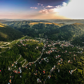 Secaria by Laurentiu Barbu - Landscapes Mountains & Hills ( dji, green, nature, tree, romania, sun, drone, home, red, hill, mountain, blue, road, sunset, hills, travel, village, forrest, landscape,  )