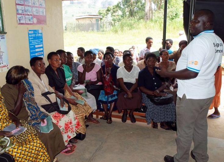 Photo: Women receive information and guidance from a member of the volunteer health team. These teams, established three years ago by UNFPA, the Ugandan Ministry of Health and the Kanungu District Local Government, are trained in family planning methods and encourage the practice in their communities.