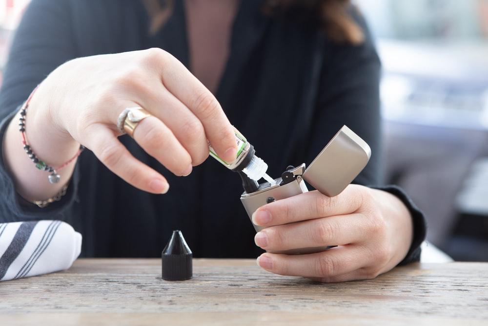 person holding silver flip lighter