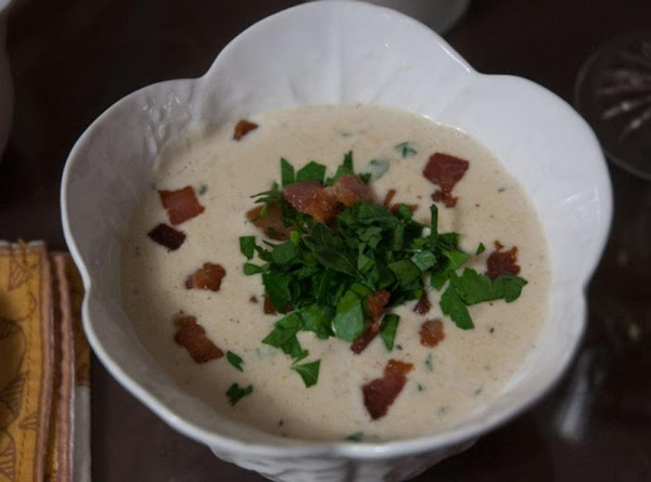 Add the crab soup to a bowl, sprinkle some parsley on top, and serve...