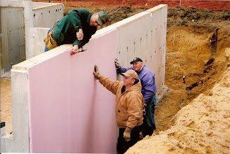 Photo: Insulating the walls.