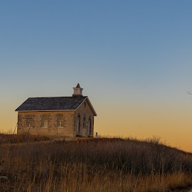 Early Evening  by Jeff Brown - Buildings & Architecture Public & Historical ( hill, one room, rocks, school, sunset, tree )