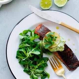 Brown Sugar and Chili-Rubbed Salmon with Avocado Crema.