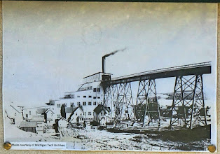 Photo: Old photo of a stamp mill whose ruins we examined. The elevated rail was used to feed copper ore into the top of the mill, so it could flow through by gravity.