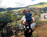 Thamsanqa Mkhize with his son Lisa at his rural