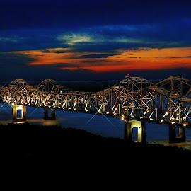 Natchez, Mississippi River Bridge by Dave Walters - Landscapes Sunsets & Sunrises ( lumix fz200, sunset, bridge, colors, natchez, mississippi river )