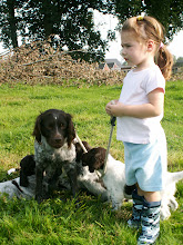 Photo: Nora samen met de pups op de weide