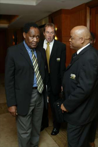 Professor Lesole Gadinabokao, left, Raymond Hack and Simon Sebapu, Safa exucutive committee members, during the Safa meeting at the Intercontinental Hotel at Johannesburg International Airport. The Safa national executive committee discussed the issue of a new Bafana Bafana coach and the report back from a disastrous African Cup of Nations. Pic: Thembinkosi Dwayisa. 6/3/04. © ST.