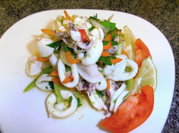 combine dressing ingredients.  in a small mixing bowl, combine squid, veggies and dressing....