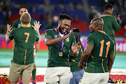 Lukhanyo Am and Mazakole Mapimpi of South Africa celebrates after the Rugby World Cup 2019 Final match between England and South Africa at International Stadium Yokohama on November 02, 2019 in Tokyo, Japan.