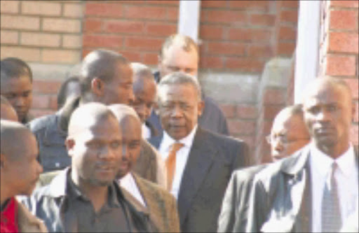 Jackie Selebi surrounded by security outside the Randburg Magistrate Court. Selebi's case was postponed to next year. PHOTO:VATHISWA RUSELO