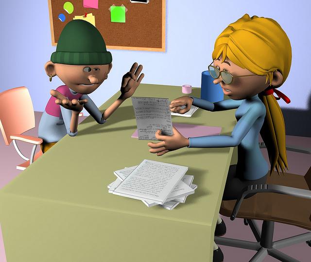 Alumno y profesora hablando