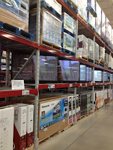 Photo: We can't go to Sam's without letting hubby dream a little in the electronics section. If he had his way, we'd have a big flat screen in every room.