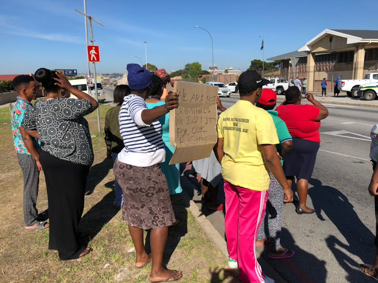 Community members from the Joe Slovo informal settlement outside the New Brighton Magistrate's Court on 16 April 2018 to support a man who flung his daughter from the roof of a shack.