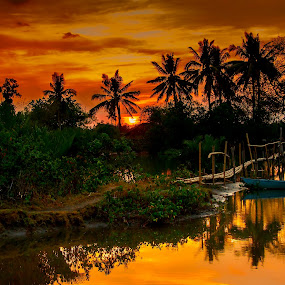 blue boat and bamboo bridge by Jerry ME Tanigue - Backgrounds Nature ( water, orange, reflection, coconut, boat, palm, sky, color, sunset, trees, bush, scenery, bridge, philippines )