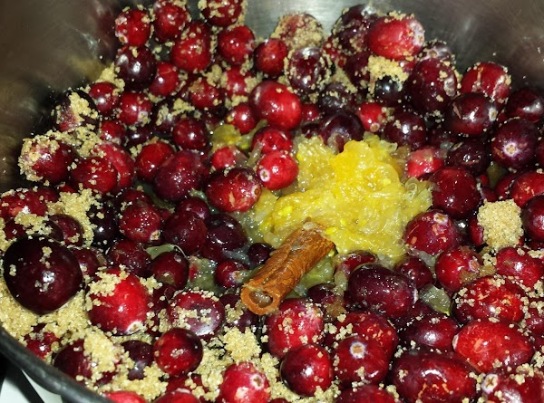 In a medium saucepan, add cranberries and brown sugar. Add orange juice and cinnamon...