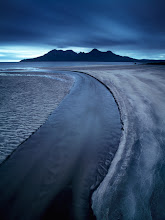 Photo: Isle of Eigg, Scotland  Once on Eigg, you can't simply escape from placing Isle of Rum on the horizon, wherever you get to. It is so amazingly photogenic, be it just a silhouette or when every detail of the island is visible.  I photographed this one the very first evening on the very end of the beach. Any other time we got there later, these sands and the creek were under water due to a high tide.  Enjoy and share!