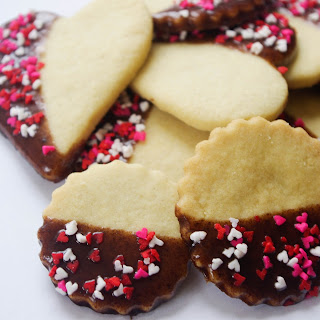 Half Chocolate Coated Sugar Cookies with Heart Sprinkles.