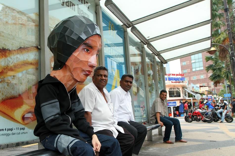 Waiting for bus is a daily headache, terrible headache make my head get bigger.