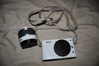 Photo: Nikon J1 digital camera in perfect condition. Has kit lens (10-30mm). This is an amazing little camera and I will be sad to see it go. I have the remote (infrared) and a case for it.  I'd like $180 but I'm a little flexible! See next few pictures for accessories.  http://www.dpreview.com/reviews/nikonv1j1
