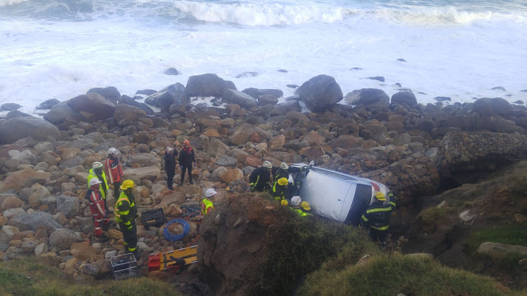 Rescue teams had to cut a motorist out of his vehicle after it crashed over a cliff in Camps Bay' Cape Town' on Friday.