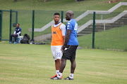 SuperSport United head coach Kaitano Tembo and star midfielder George Lebese during a training session at Megawatt Park in Johannesburg.