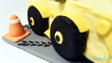 Photo: Caution: Blake's 3-year-old bulldozer birthday cake ahead! A yummy chocolate cake with cream cheese frosting.