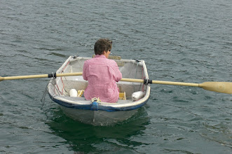 Photo: The mate rowing Nahani's dinghy