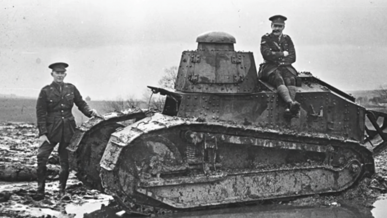 Photo of two men during World War I with a Renault FT-17 light tank