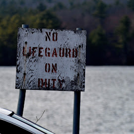 Caution sign at lake near Newport by Govindarajan Raghavan - City,  Street & Park  Street Scenes