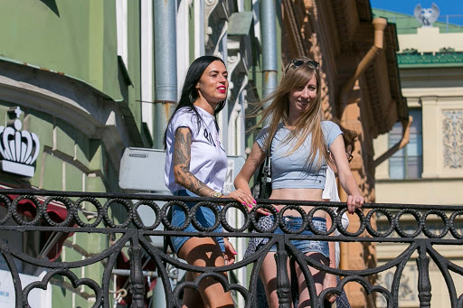 Local women look out from an overpass along the edges of a canal  in St. Petersburg, Russia.