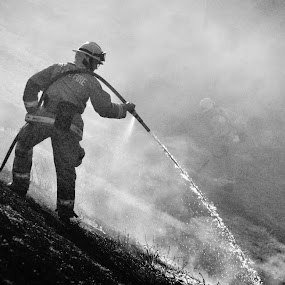 Fire erupts in American River Parkway by Kati Garner - News & Events US Events ( water, grass fire, firemen, smoke, fire )