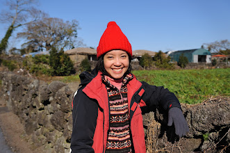Photo: As we walked deeper into Seongeup Folk Village, we were greeted by a large green field.