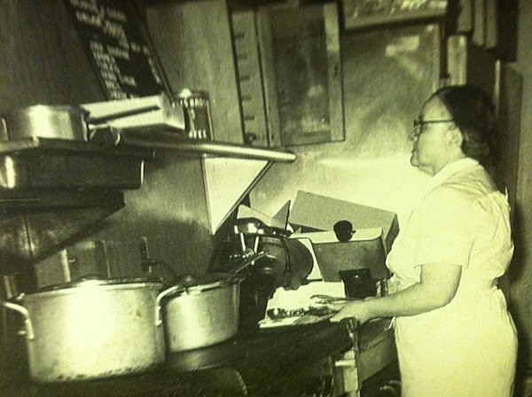 My dear grandmother Marie Salzer, cooking in her diner.