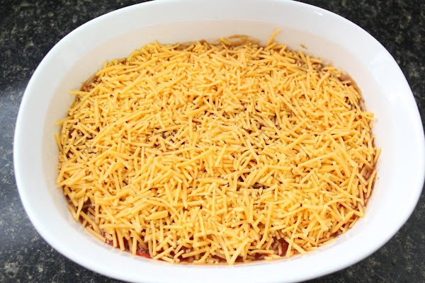 Next, 1 cup shredded cheese evenly layered over salsa.