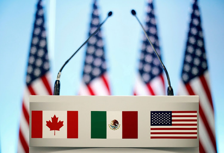 The flags of Canada, Mexico and the US on a lectern in Mexico City, Mexico. Picture: REUTERS