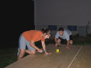 Photo: Here you can see my brother and his fiance, Lauren, nailing down the plywood. We got a lot done in a short amount of time, considering we're not carpenters!  Oh...and yes...I actually did a lot of work. I'm also the picture taker, so you may not see a lot of pictures of me. :)