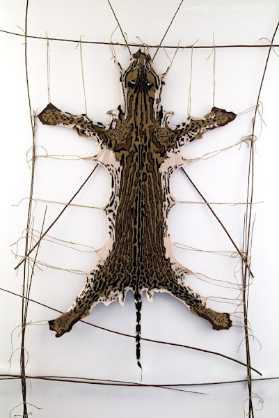 "Photo: #5 Ocelot 2010 53"" x 32"" (134cm x 81cm) Hand knitted textile. Interpretation of ocelot based on study of actual pelt at American Museum of Natural History. Male - collected from Peru 1930. Yarn, string, sticks. (C) Ruth Marshall, 2010."