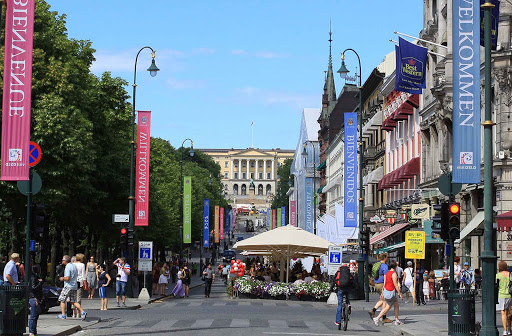 Stroll through Karl Johans Gate, a popular pedestrian thoroughfare in Oslo, Norway.