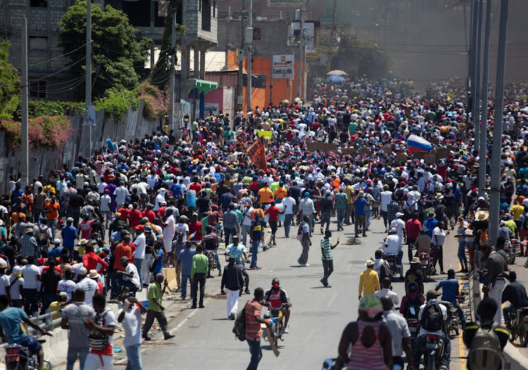 Demonstrators protest against the government of President Jovenel Moïse in Port-au-Prince, Haiti, March 28 2021. Picture: REUTERS/ESTAILOVE St-VAL