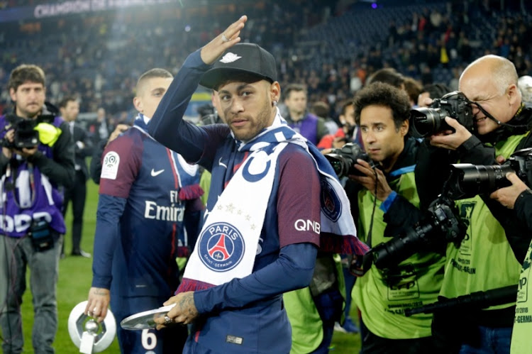Neymar Jr of Paris Saint Germain celebrates the championship during the French League 1 match between Paris Saint Germain v Rennes at the Parc des Princes on May 12, 2018 in Paris France.