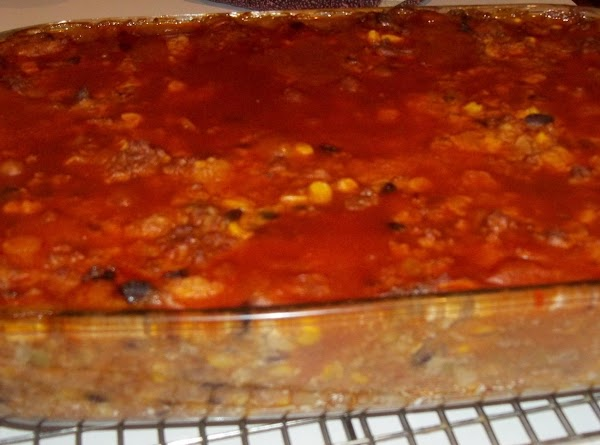 Top with the remaining enchilada sauce. Bake in the preheated oven for 50 minutes.