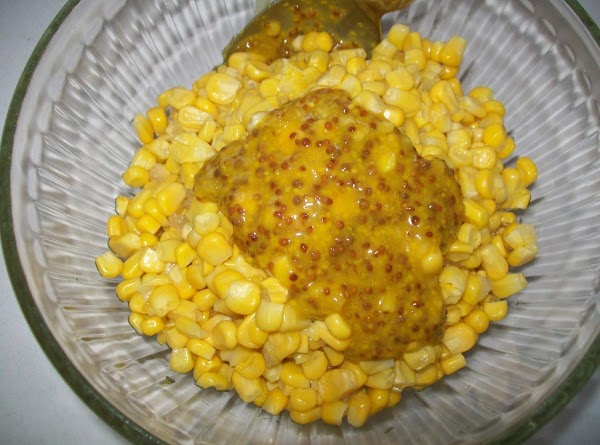 While the butter is getting brown mix the mustard and corn together.