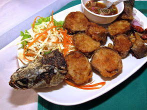 """Photo: Fried """"sai oa"""" fish sausage, a delicious and spicy Khai Mook specialty"""