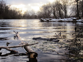 Photo: Sunset over a snowy pond at Eastwood Park in Dayton, Ohio.