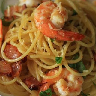 Spaghetti Pasta With Garlic Butter Prawns, Crispy Bacon And Chilli Flakes.