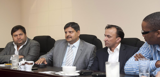 Indian businessmen, Ajay Gupta (L) and younger brother Atul Gupta, Oakbay (C) MD Jagdish Parekh (R) with Sahara director, Duduzane Zuma (Far Right). File photo