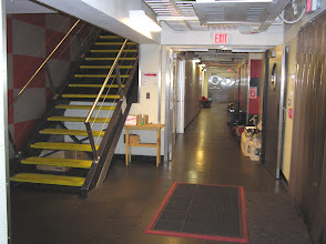 "Photo: Stairs between levels and hallway toward the ""Beer Can"" end of the station."