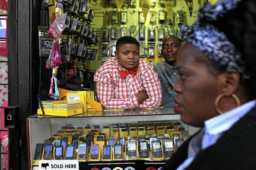 Hustle and bustle: Samantha's Cell Plus Sound shop in the Joburg CBD. Due to poor policy implementation, small black businesses have fallen into the hands of new players, predominantly from the Asian continent. Picture: JAMES OATWAY